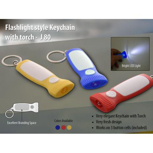 Flashlight style keychain with torch